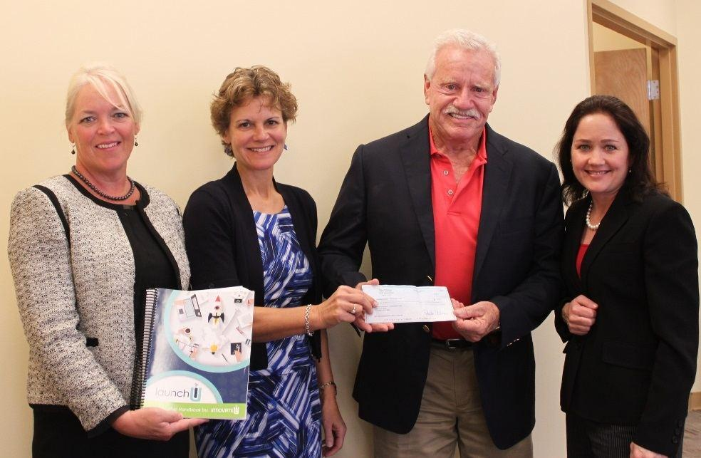 Grant will help enterprising women at Naples shelter with workbook costs
