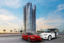 Massive sign in Dubai teases free Tesla when purchasing a home from the builder