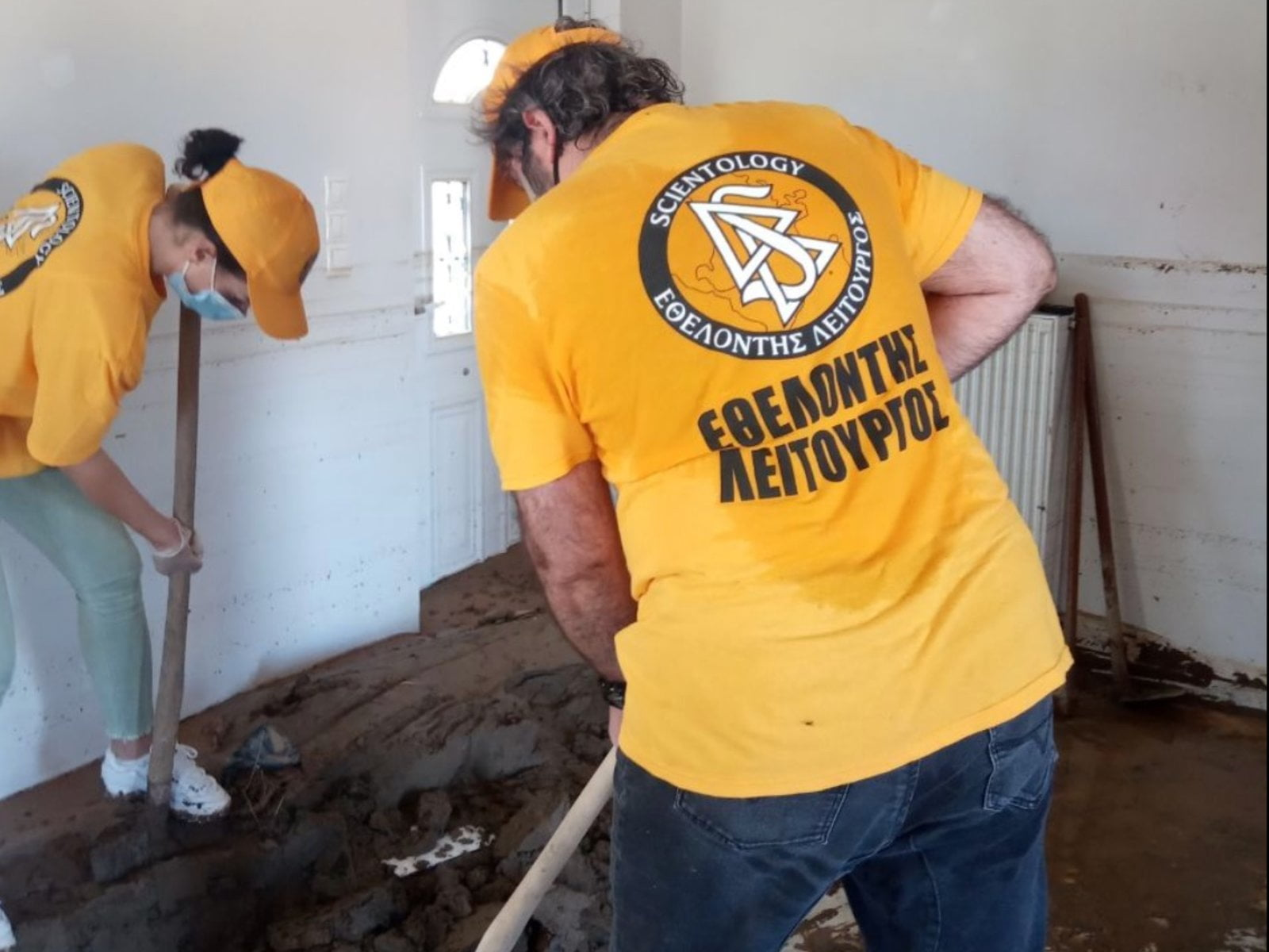 On the Isle of Evia, Scientology Volunteer Ministers Help Flood Victims Clean Up Their Homes