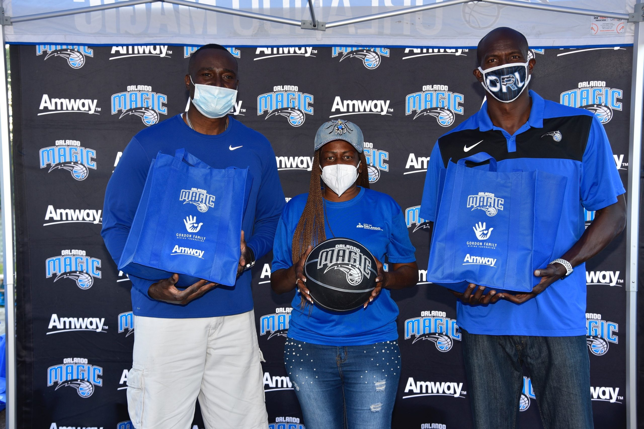 Magic Player Aaron Gordon Helps Sponsor the Magic and Amway Corporation's Car Trunk Turkey Dinner Distribution for Local Families in Need