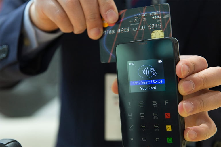 What are the pros and cons of debit cards and credit cards?